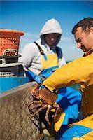 Fisherman at work on boat Stock Photo - Premium Royalty-Freenull, Code: 649-06489864