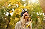 Woman playing in autumn leaves outdoors Stock Photo - Premium Royalty-Free, Artist: Aflo Relax, Code: 649-06489880