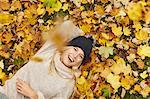 Woman laying in autumn leaves outdoors Stock Photo - Premium Royalty-Free, Artist: Photocuisine, Code: 649-06489883