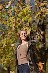 Woman playing in autumn leaves Stock Photo - Premium Royalty-Free, Artist: Aflo Sport, Code: 649-06489921