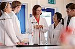 Students and teacher in chemistry lab Stock Photo - Premium Royalty-Free, Artist: Cultura RM, Code: 649-06489936