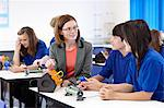Teacher with students in science class Stock Photo - Premium Royalty-Free, Artist: Blend Images, Code: 649-06489961