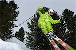 Skier jumping on snowy slope Stock Photo - Premium Royalty-Free, Artist: Robert Harding Images, Code: 649-06490009