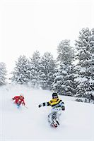 sports and snowboarding - Skier and snowboarder on snowy slope Stock Photo - Premium Royalty-Freenull, Code: 649-06490012