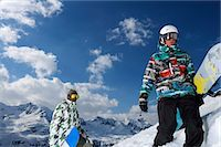 Snowboarders on snowy mountaintop Stock Photo - Premium Royalty-Freenull, Code: 649-06490024