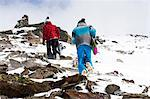 Snowboarders hiking on rocky slope Stock Photo - Premium Royalty-Free, Artist: Robert Harding Images, Code: 649-06490036