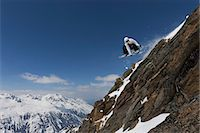 Snowboarder jumping on rocky slope Stock Photo - Premium Royalty-Freenull, Code: 649-06490040
