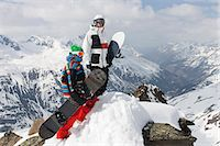 Snowboarders on rocky mountaintop Stock Photo - Premium Royalty-Freenull, Code: 649-06490042