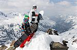 Snowboarders on rocky mountaintop Stock Photo - Premium Royalty-Free, Artist: AWL Images, Code: 649-06490042