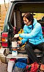 Hiker making tea in car trunk Stock Photo - Premium Royalty-Free, Artist: AWL Images, Code: 649-06490090