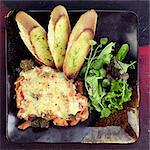 Pasta Bake with Garlic Bread and Side Salad Stock Photo - Premium Rights-Managed, Artist: foodanddrinkphotos, Code: 824-06491352
