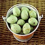 Green chocolate mini eggs in a pail Stock Photo - Premium Rights-Managed, Artist: foodanddrinkphotos, Code: 824-06492027