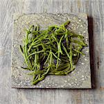 Samphire on a stone surface Stock Photo - Premium Rights-Managed, Artist: foodanddrinkphotos, Code: 824-06492163