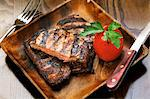 Grilled steak with a tomato Stock Photo - Premium Royalty-Freenull, Code: 659-06493863