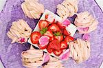Meringues filled with chestnut cream and fresh strawberries on a purple plate Stock Photo - Premium Royalty-Free, Artist: Beth Dixson, Code: 659-06494265