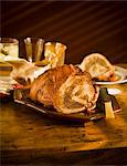 Turducken on a Platter on Wooden Table Stock Photo - Premium Royalty-Freenull, Code: 659-06494337