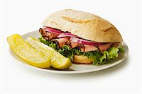 food - Pastrami Sandwich on a Roll with Two Dill Pickle Spears Stock Photo - Premium Royalty-Freenull, Code: 659-06494469