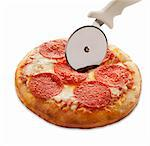 Mini Pepperoni Pizza with Pizza Cutter on a White Background Stock Photo - Premium Royalty-Free, Artist: CulturaRM, Code: 659-06494475