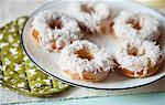 Coconut Doughnuts on a Plate Stock Photo - Premium Royalty-Free, Artist: Blend Images, Code: 659-06494523