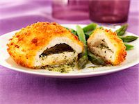 Chicken kiev with garlic butter, herbs and asparagus Stock Photo - Premium Royalty-Freenull, Code: 659-06494733