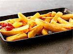Ketchup on French fries, close-up, elevated view Stock Photo - Premium Royalty-Free, Artist: Photocuisine, Code: 659-06494742