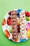 Marshmallow kebabs on a colourful paper plate Stock Photo - Premium Royalty-Free, Artist: Cultura RM, Code: 659-06495009
