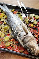 Sea bass on bed of vegetables Stock Photo - Premium Royalty-Freenull, Code: 659-06495166