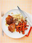 Chicken legs with curry, carrots, rice and lime zest Stock Photo - Premium Royalty-Freenull, Code: 659-06495315