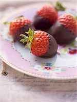 strawberries - Chocolate strawberries on a pink, floral-patterned plate Stock Photo - Premium Royalty-Freenull, Code: 659-06495417