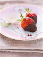 strawberries - Chocolate strawberries on a pink, floral-patterned plate Stock Photo - Premium Royalty-Freenull, Code: 659-06495418