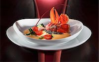 Lobster with pearl barely risotto, lobster foam, mushrooms, cherry tomatoes and spinach Stock Photo - Premium Royalty-Freenull, Code: 659-06495501