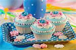 Light blue cupcakes decorated with pink flowers and sugar balls Stock Photo - Premium Royalty-Free, Artist: Cultura RM, Code: 659-06495719