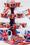 Union Jacks on cupcakes, a cake stand, a teapot and tea cups Stock Photo - Premium Royalty-Free, Artist: Aurora Photos, Code: 659-06495728