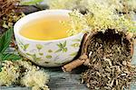 A bowl of meadowsweet tea and tea leaves in a tea strainer Stock Photo - Premium Royalty-Free, Artist: photo division, Code: 659-06495737