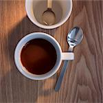 A cup of coffee with a coffee spoon Stock Photo - Premium Royalty-Free, Artist: Ron Fehling, Code: 659-06495764