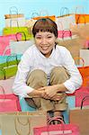 A lot of shopping bags and the woman who sit down Stock Photo - Premium Royalty-Free, Artist: JTB Photo, Code: 6106-06495829
