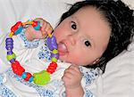 Baby girl (2-5) month chewing on teething ring Stock Photo - Premium Royalty-Free, Artist: Cusp and Flirt, Code: 6106-06496162