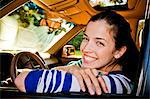 A young girl with her car smiling with confidence. Stock Photo - Premium Royalty-Freenull, Code: 6106-06496371