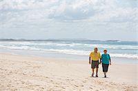 Seniors Walking on the Beach Stock Photo - Premium Royalty-Freenull, Code: 6106-06497120