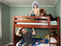 father son shirtless - Father looking at kids who are wearing rocker wigs Stock Photo - Premium Royalty-Freenull, Code: 6106-06497183