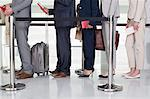 Business people standing in queue at airport Stock Photo - Premium Royalty-Free, Artist: Michael Mahovlich, Code: 6113-06497806