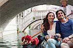 Smiling couple riding in gondola in Venice Stock Photo - Premium Royalty-Free, Artist: Cultura RM, Code: 6113-06498079