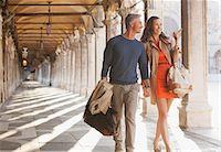Smiling couple walking along corridor in Venice Stock Photo - Premium Royalty-Freenull, Code: 6113-06498088