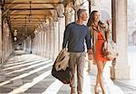 Smiling couple walking along corridor in Venice Stock Photo - Premium Royalty-Freenull, Code: 6113-06498088