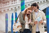 Smiling couple walking with map in Venice Stock Photo - Premium Royalty-Freenull, Code: 6113-06498093