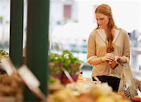 Woman shopping in outdoor market Stock Photo - Premium Royalty-Freenull, Code: 6113-06498109