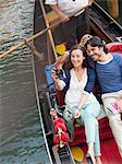 Smiling couple taking photographs in gondola on canal in Venice Stock Photo - Premium Royalty-Free, Artist: Minden Pictures, Code: 6113-06498136