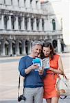 Smiling couple looking at guidebook in St. Mark's Square in Venice Stock Photo - Premium Royalty-Free, Artist: Cultura RM, Code: 6113-06498178