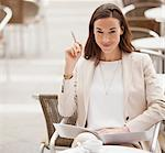 Portrait of smiling businesswoman with paperwork at sidewalk cafe Stock Photo - Premium Royalty-Free, Artist: Uwe Umstätter, Code: 6113-06498277