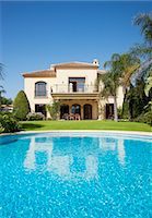 Luxury swimming pool and Spanish villa Stock Photo - Premium Royalty-Freenull, Code: 6113-06498323